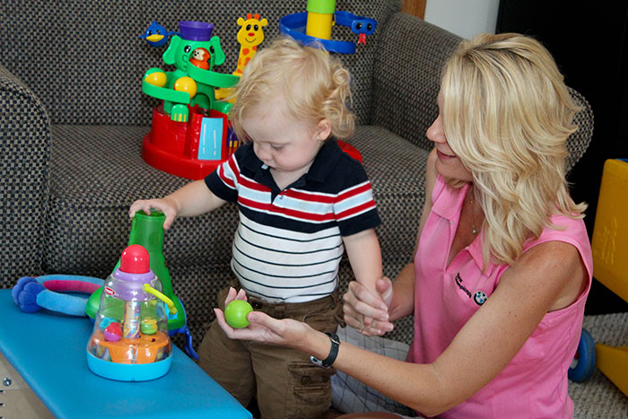 child plays during therapy
